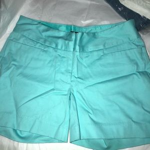 The limited size 4 teal dress shorts